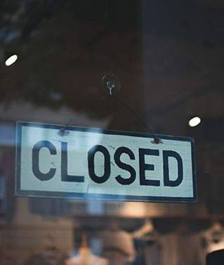 "A ""Closed"" sign representing that we can assist with the dissolution of an entity."