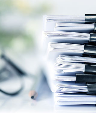 A large stack of documents to represent the document retrieval services we offer.