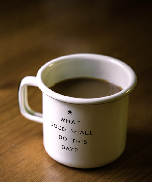 "Coffee cup with following text written on it: ""What good shall I do this day?"""
